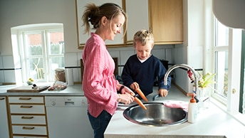 woman cooking with her son